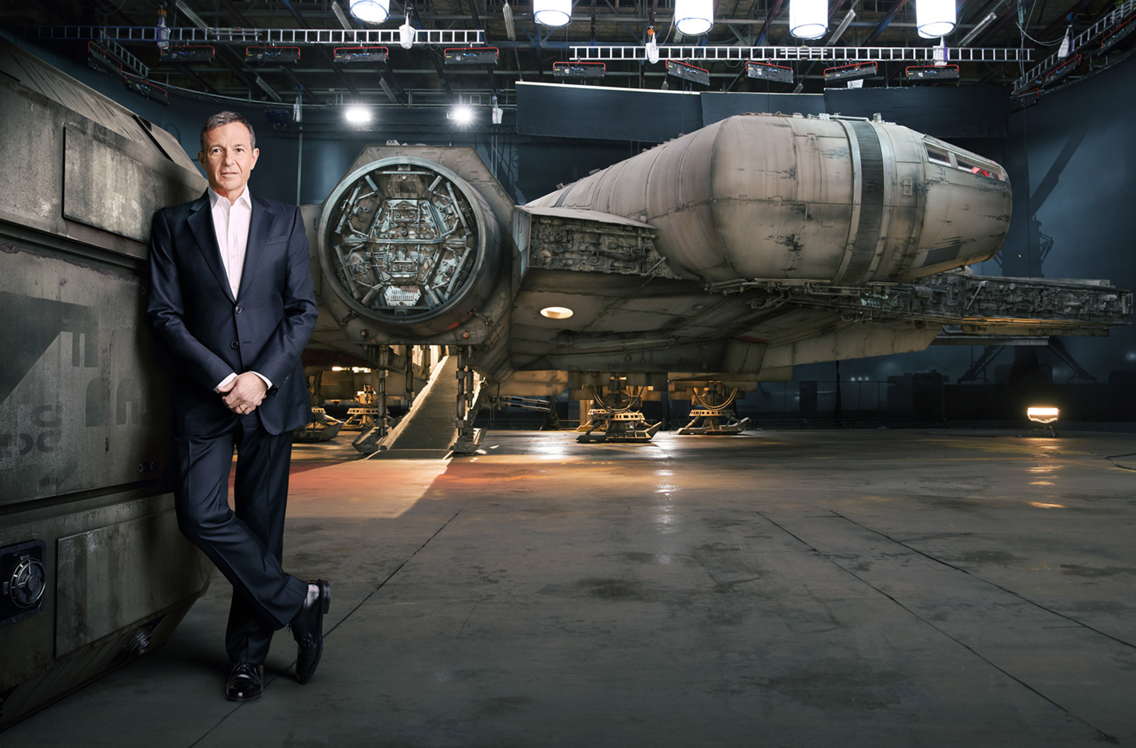 Bob Iger standing in front of the Millennium Falcon